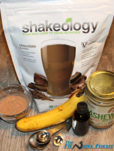 Ingredients used in this brownie recipe - Shakeology protein powder, cocoa powder, banana, vanilla extract, and cashew butter.